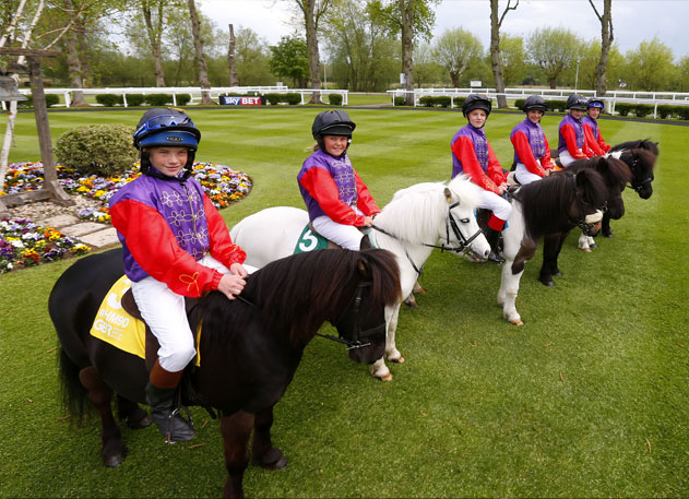 Jockeys-and-ponies-line-up-in-the-Royal-Windsor-Racecourse-parade-ring